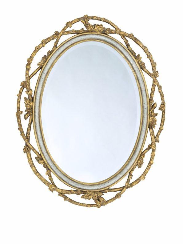 Gold trimmed floral framed mirror for home decor.