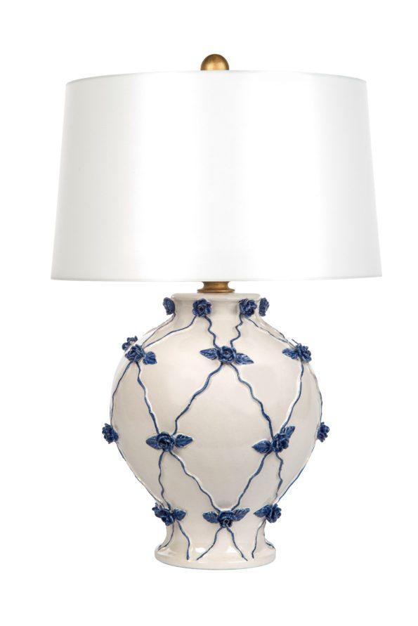 Blue floral design adorns white lamp.