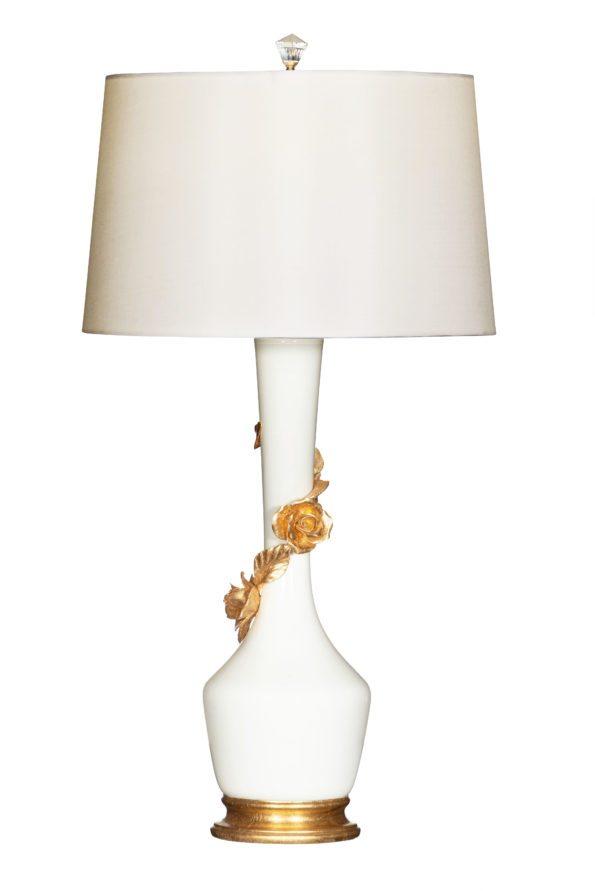 Gold floral design adorns white lamp.